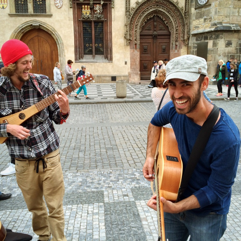 Playing if front of the astronomical clock in Prague.