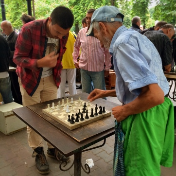 Playing chess against locals.