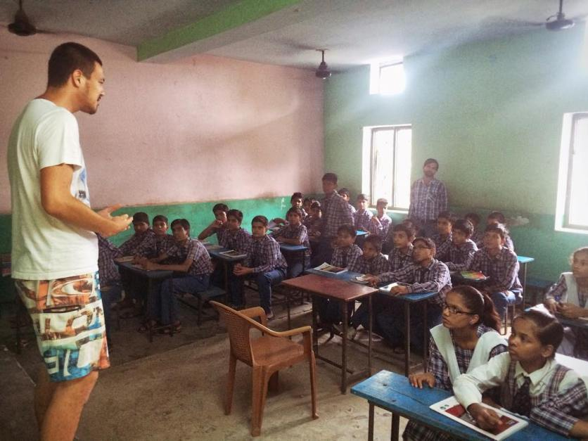 Listen to the guy in the swim shorts. English teaching in action.